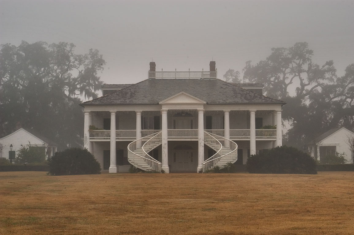 Evergreen Plantation in fog, view from Old River Rd.. Vacherie, Louisiana