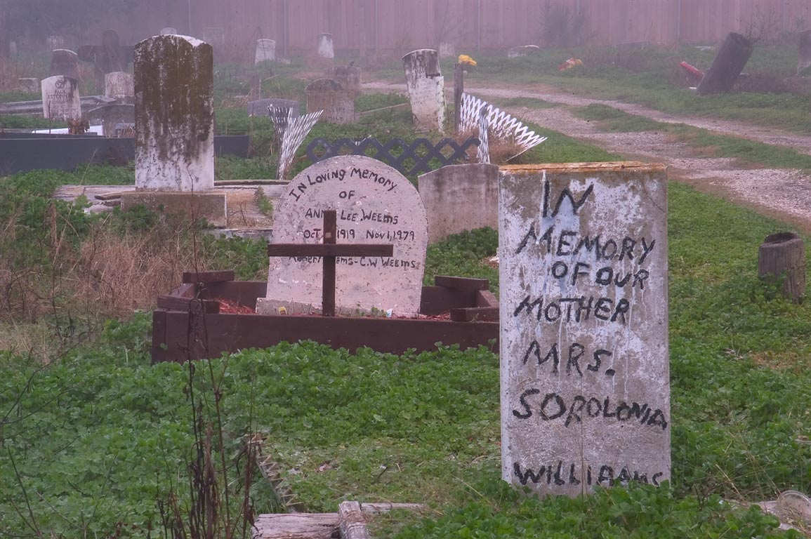 Makeshift headstones in Holt Cemetery in fog. New Orleans, Louisiana