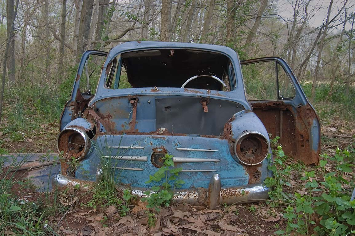 An old car on Red Trail in Six Mile Run Reservoir, near Cross Brook. Somerset, New Jersey