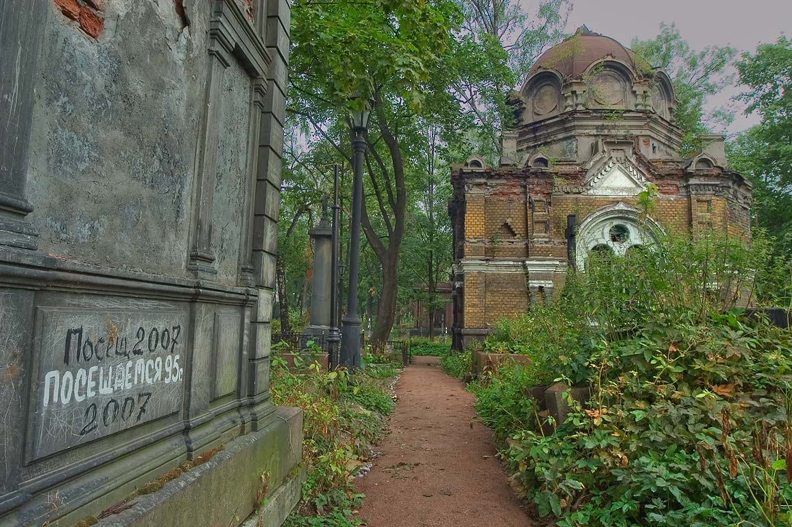 Alley and a crypt in Nikolskoe Cemetery of Alexander Nevsky Lavra. St.Petersburg, Russia