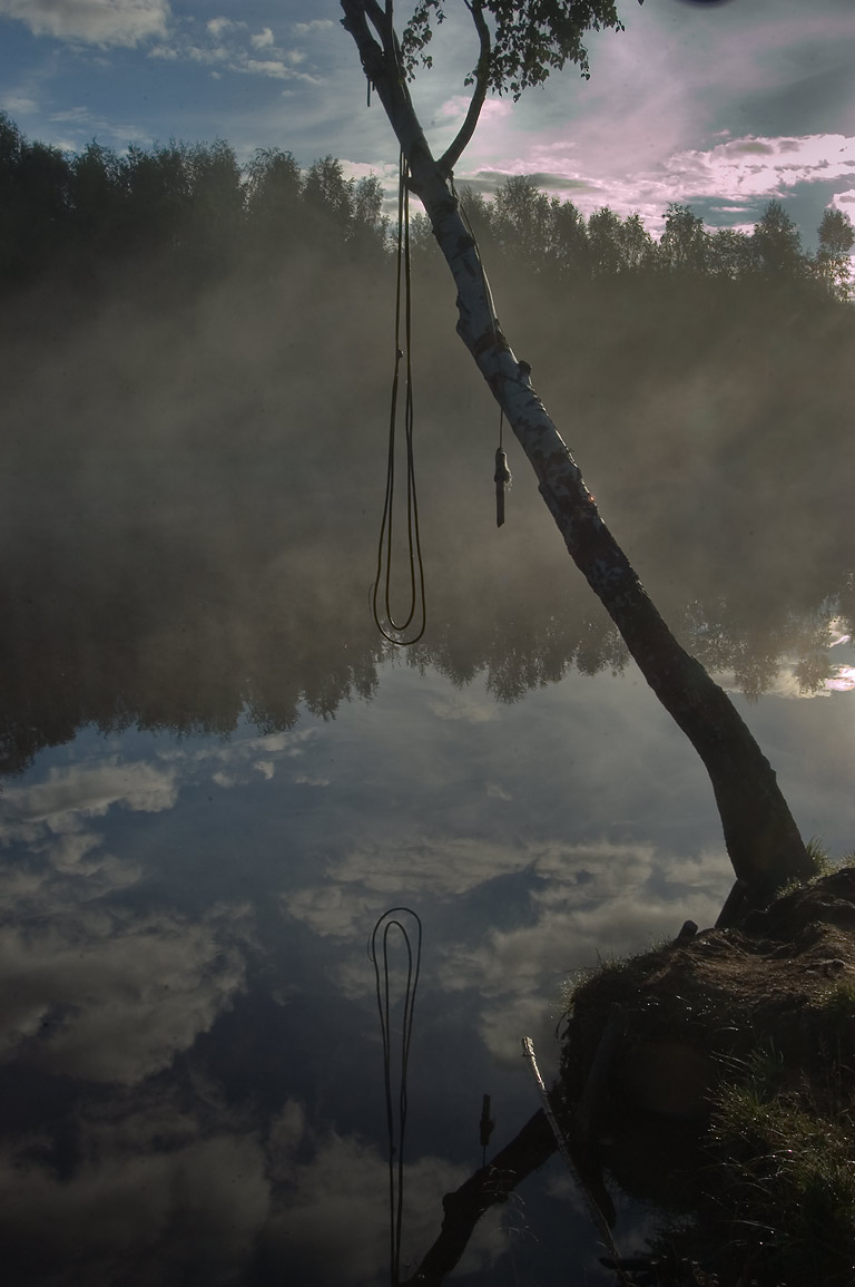Rope swing for diving to a lake in northern part...Park at morning. St.Petersburg. Russia