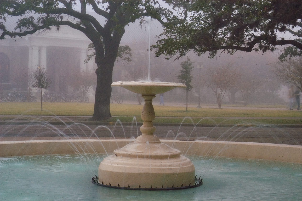 Fish Pond Water Fountain on campus of Texas A and...in fog. College Station, Texas