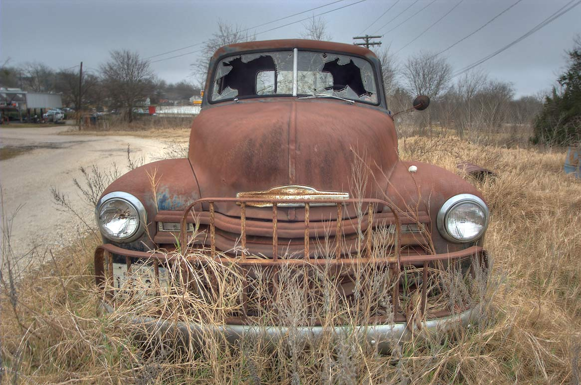 Rusty car on Houston St.. Anderson, Texas