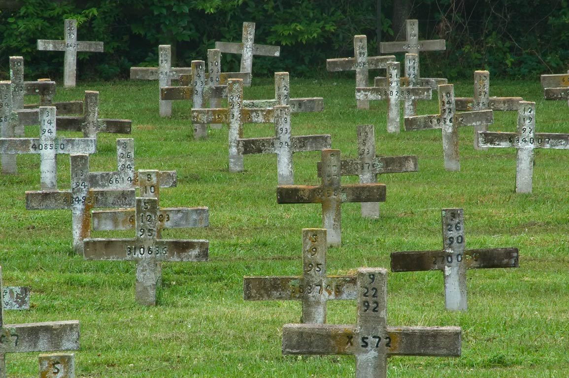Crosses on tombs of prisoners in Captain Joe Byrd...Hill) Cemetery. Huntsville, Texas