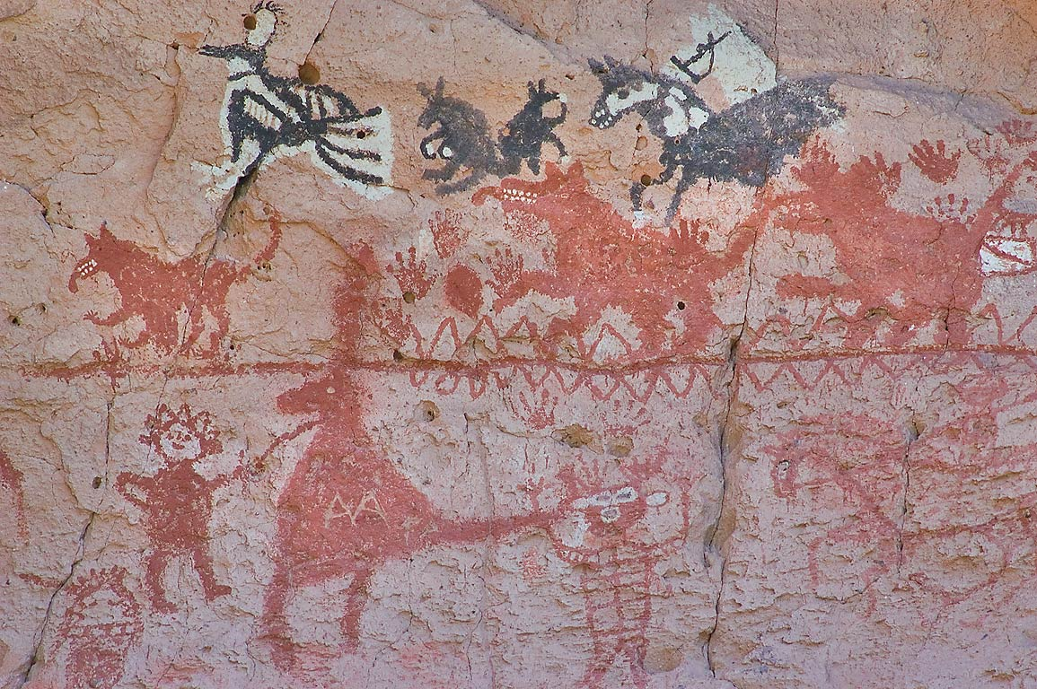 Figures of people and animals in Painted Cave in...Monument. New Mexico, near Los Alamos