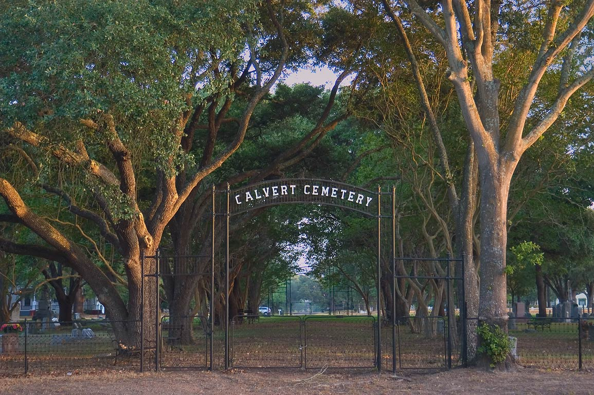 Gates of Calvert Cemetery (est. 1870) at morning. Calvert, Texas
