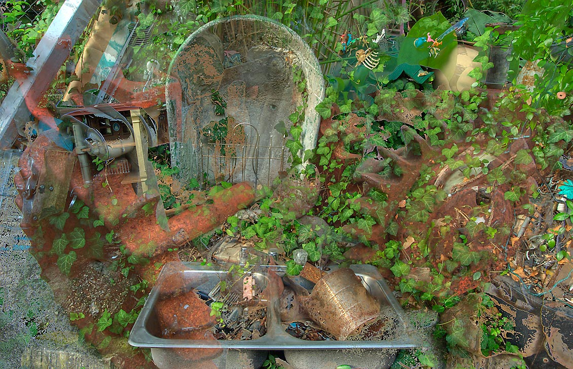 Mock cemetery (superimposed images) of Cathedral...s backyard folk art). Austin, Texas