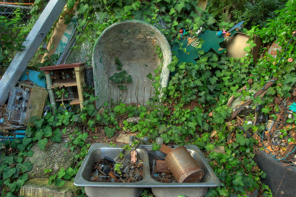 Mock graveyard of Cathedral of Junk at 4422...s backyard folk art). Austin, Texas