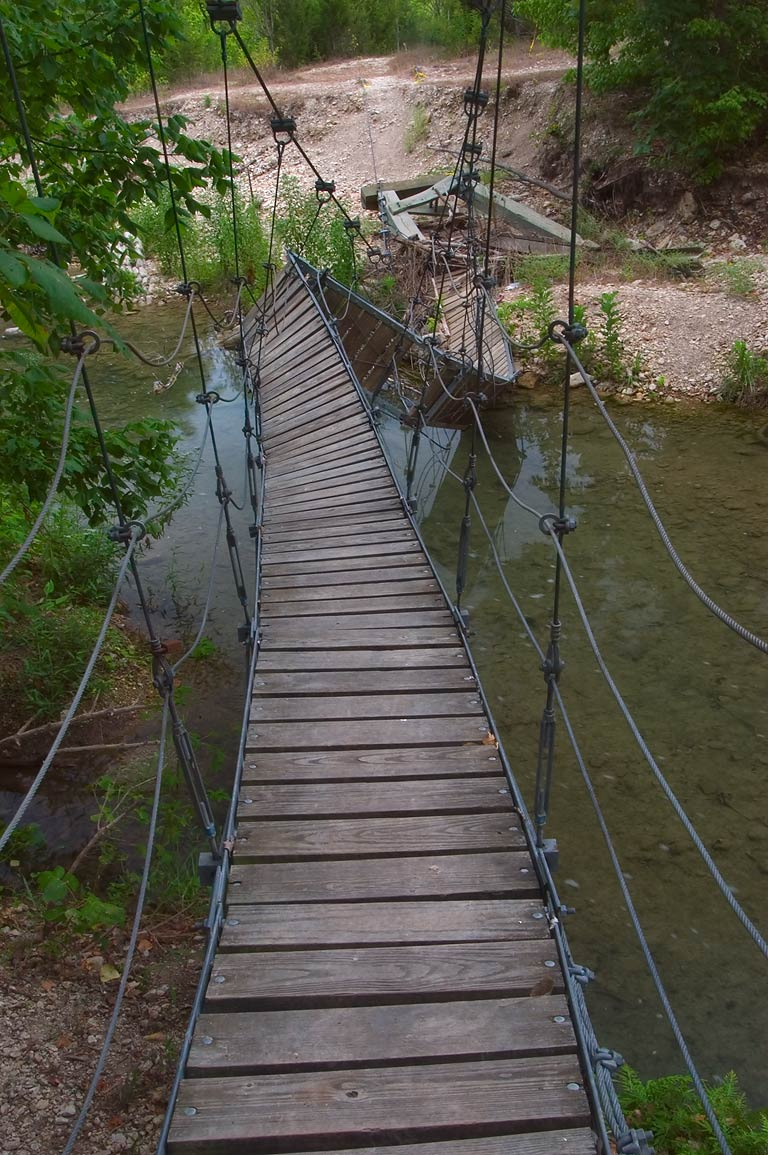 Old suspension bridge over a tributary of...Falls Park. Belton-Killeen, Texas