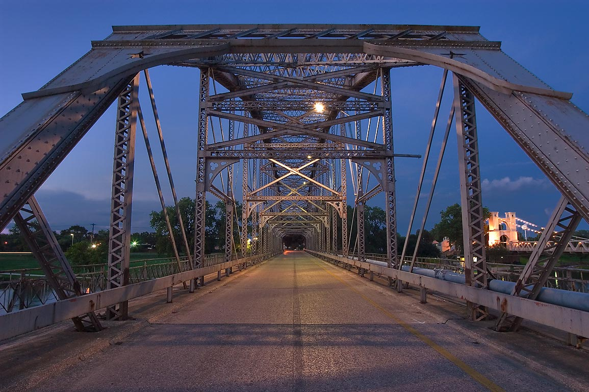 Steel arch bridge spanning Brazos River...in 1901), from south-west. Waco, Texas