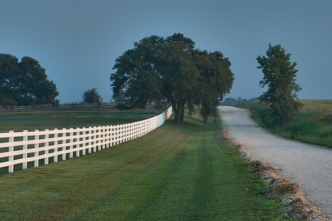 White fence of Guzman Ranch at Old Independence Rd.. Independence, Texas