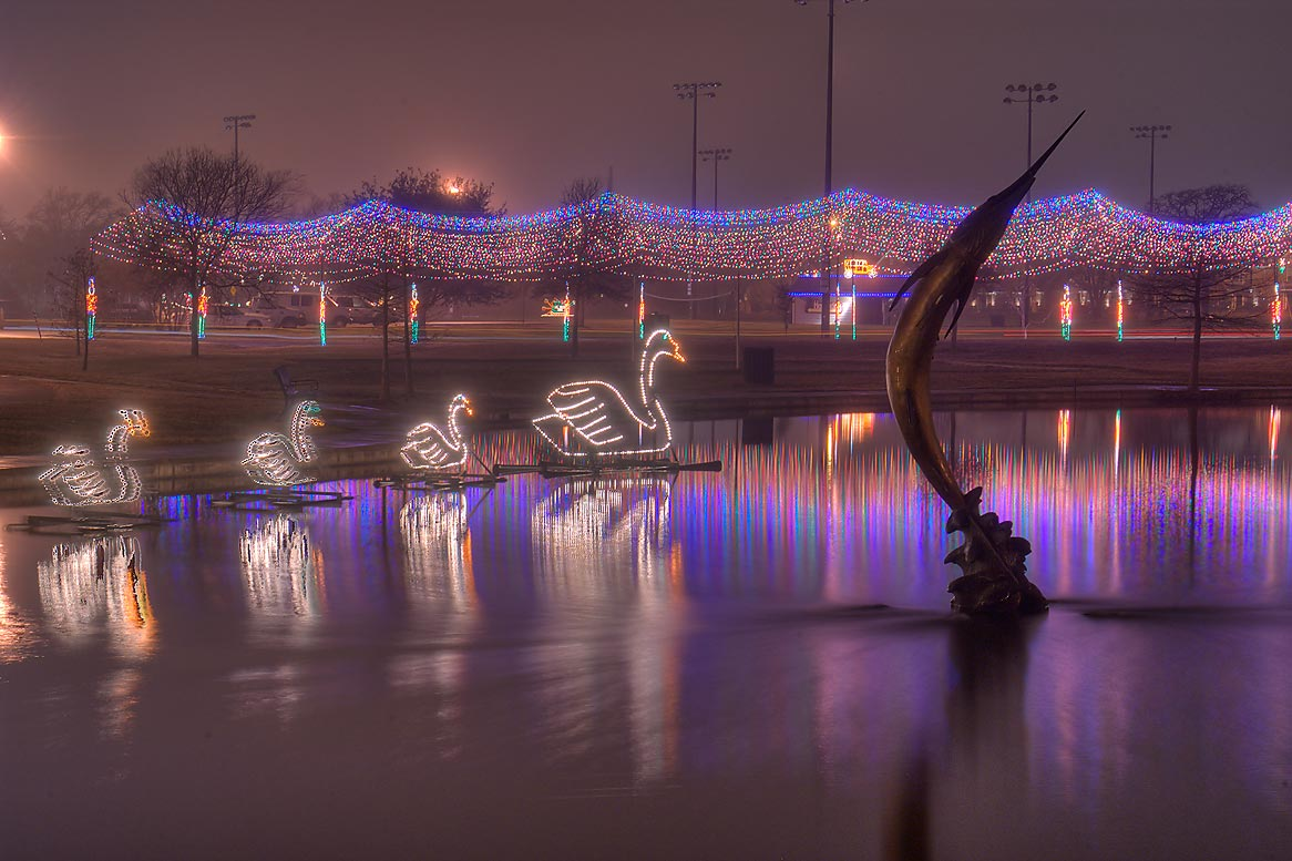 Christmas lights reflected in a pond of Central Park. College Station, Texas