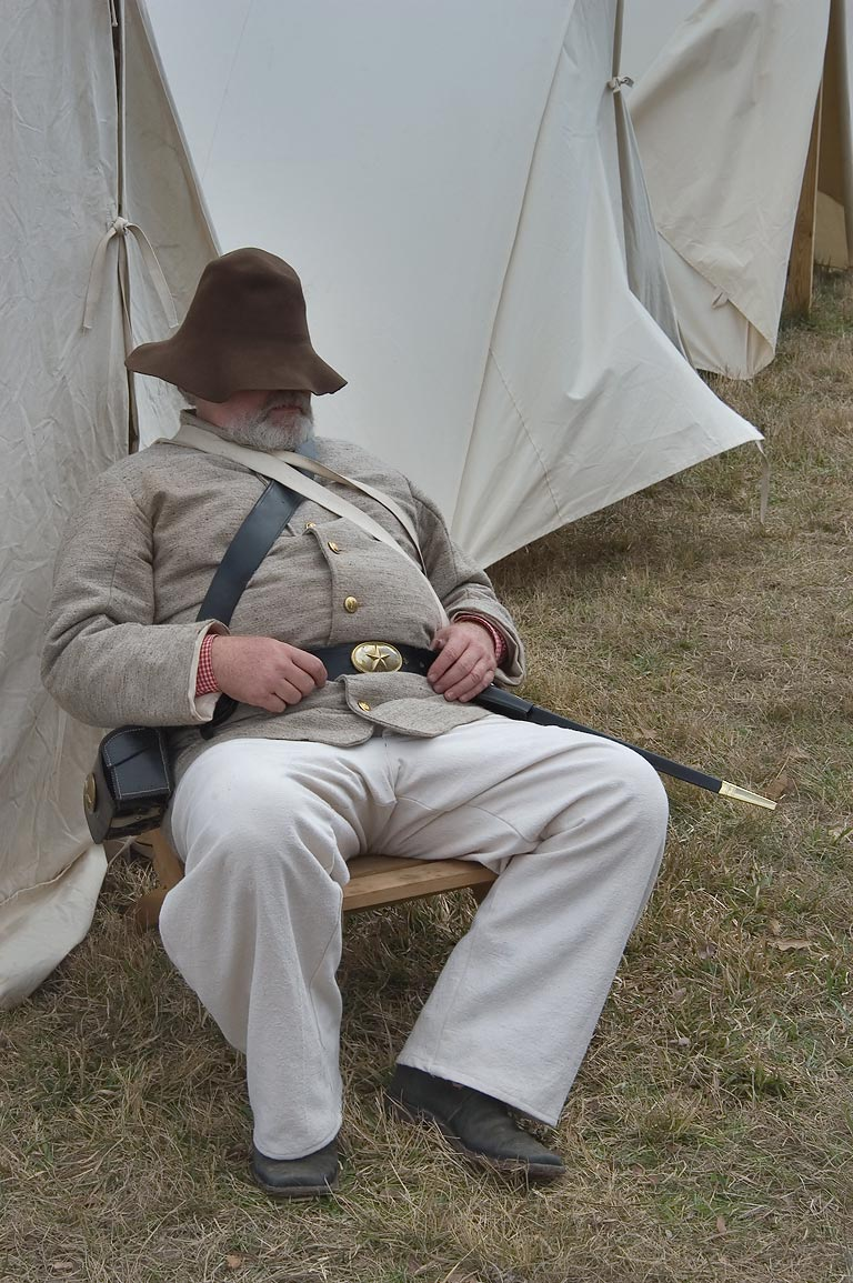 Actor in authentic period costume sleeping in a...at Lake Madison. Madisonville, Texas