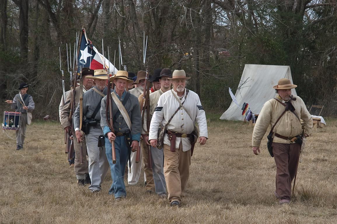 Group of soldiers with rifles at third annual 8th...at Lake Madison. Madisonville, Texas