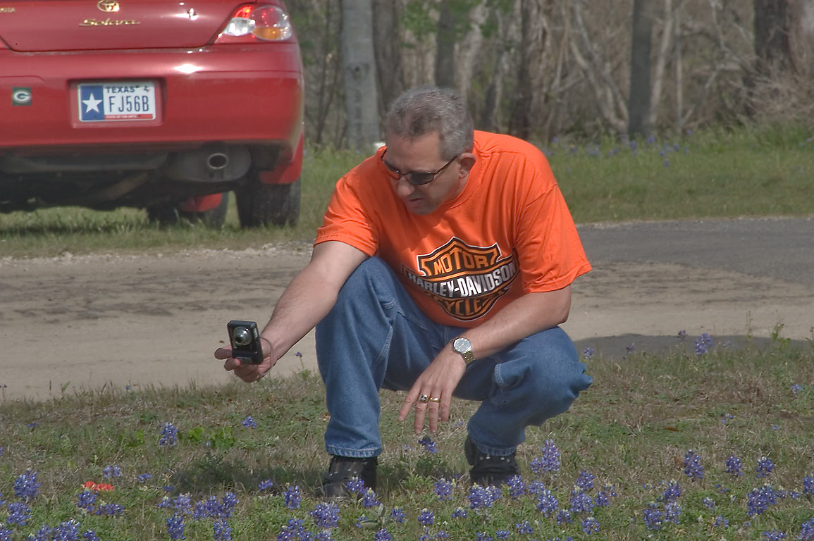 Taking pictures of bluebonnet flowers in Old Bailor park. Independence, Texas