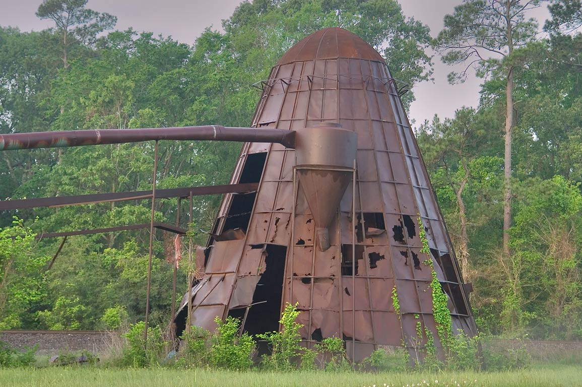 Rusty dome of Giles Lumber Mill at 23249 Highway...on top as a spark resistor. Texas