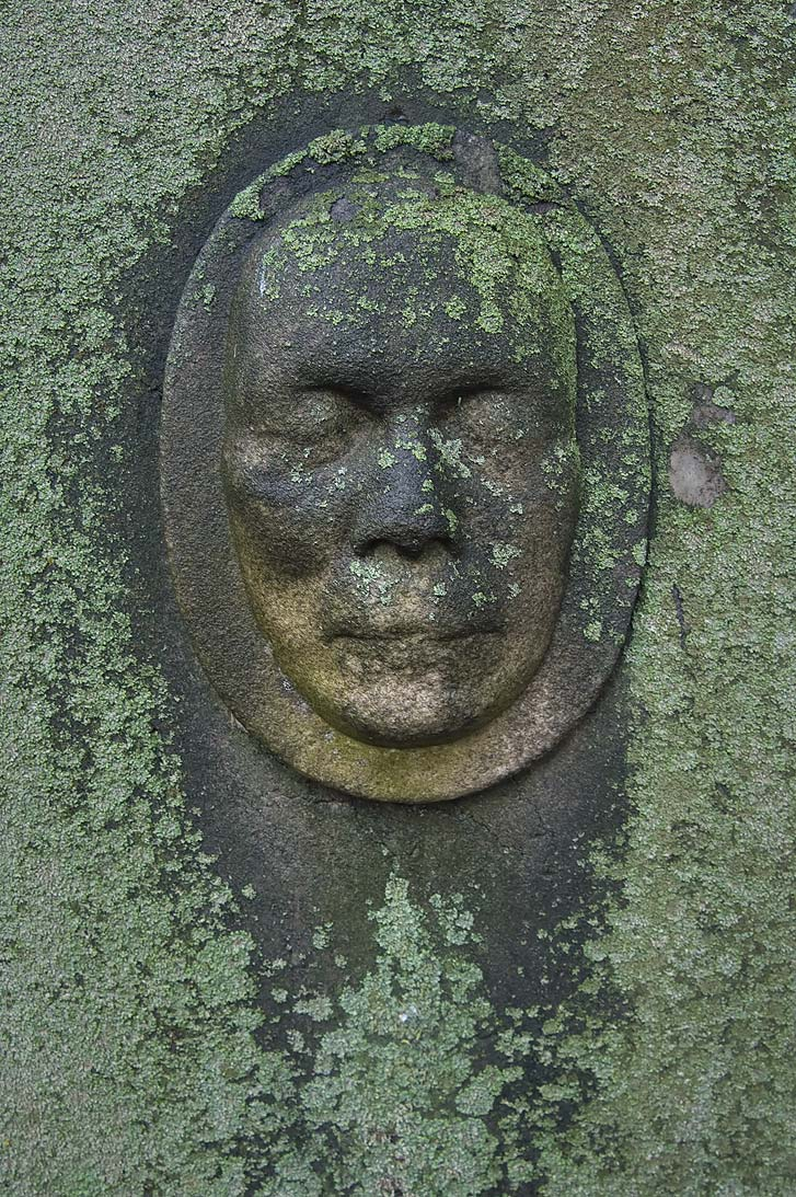 Human face embossed on a tomb in Necropolis of...Cemetery). St.Petersburg, Russia