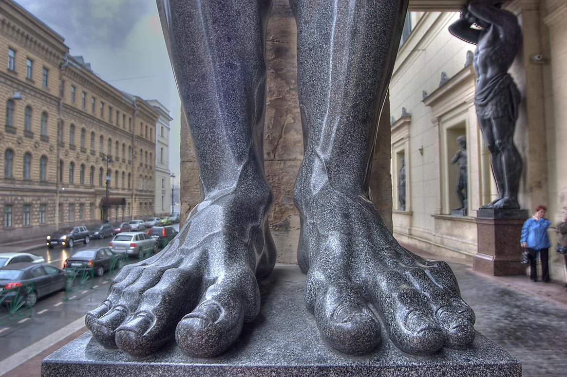 Granite feet of one of ten Atlantes supporting a...extension. St.Petersburg, Russia