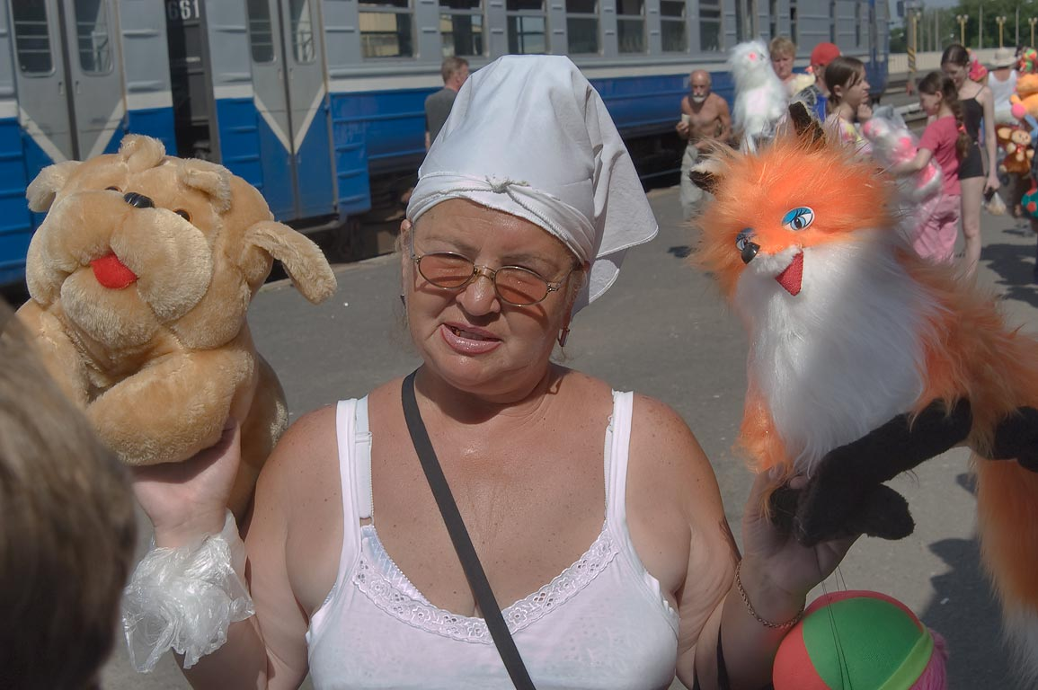 Merchant from artificial fur factory selling soft...of train station Zhlobin. Belorussia
