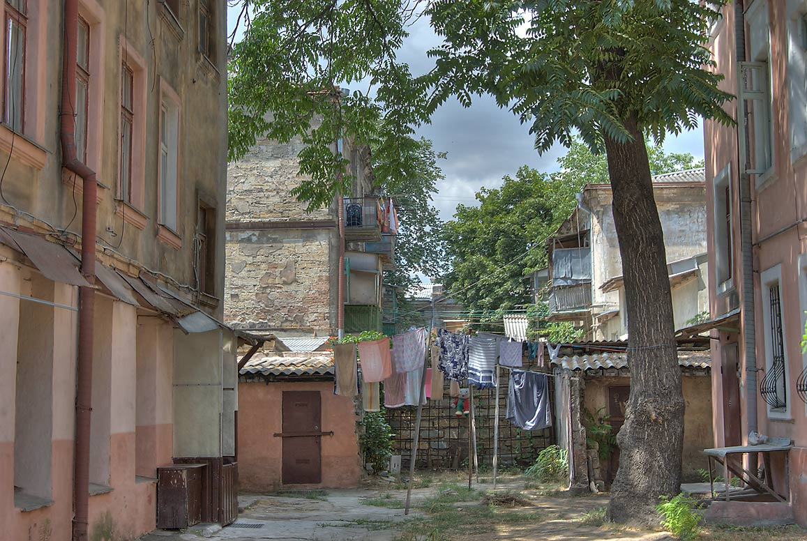 Courtyard with laundry and acacia tree at 10...neighborhood. Odessa, Ukraine