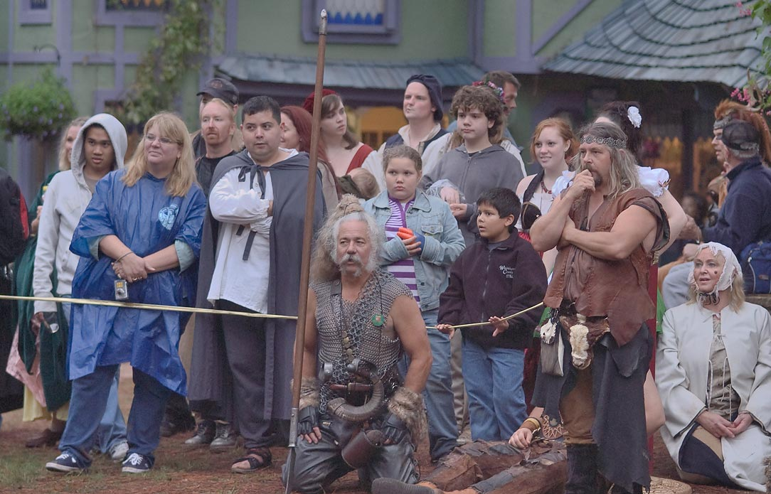 Visitors watching a performance at Texas Renaissance Festival. Plantersville, Texas