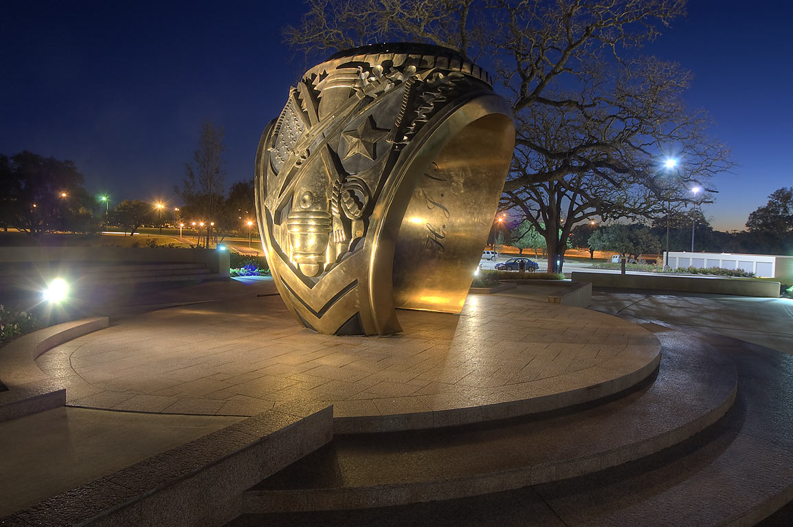 Aggie ring sculpture behind Clayton Williams...at dusk. College Station, Texas