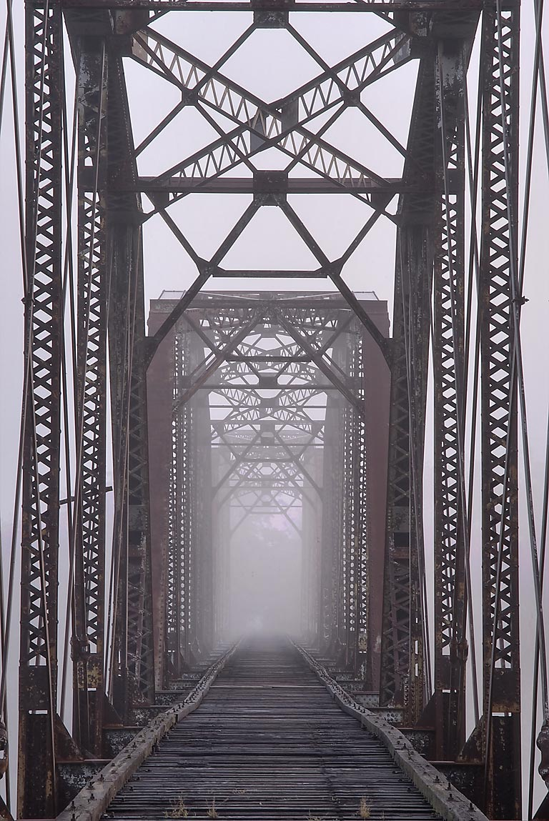 Waco - College Station, Texas  - Railroad bridge in mist. Waco, Texas