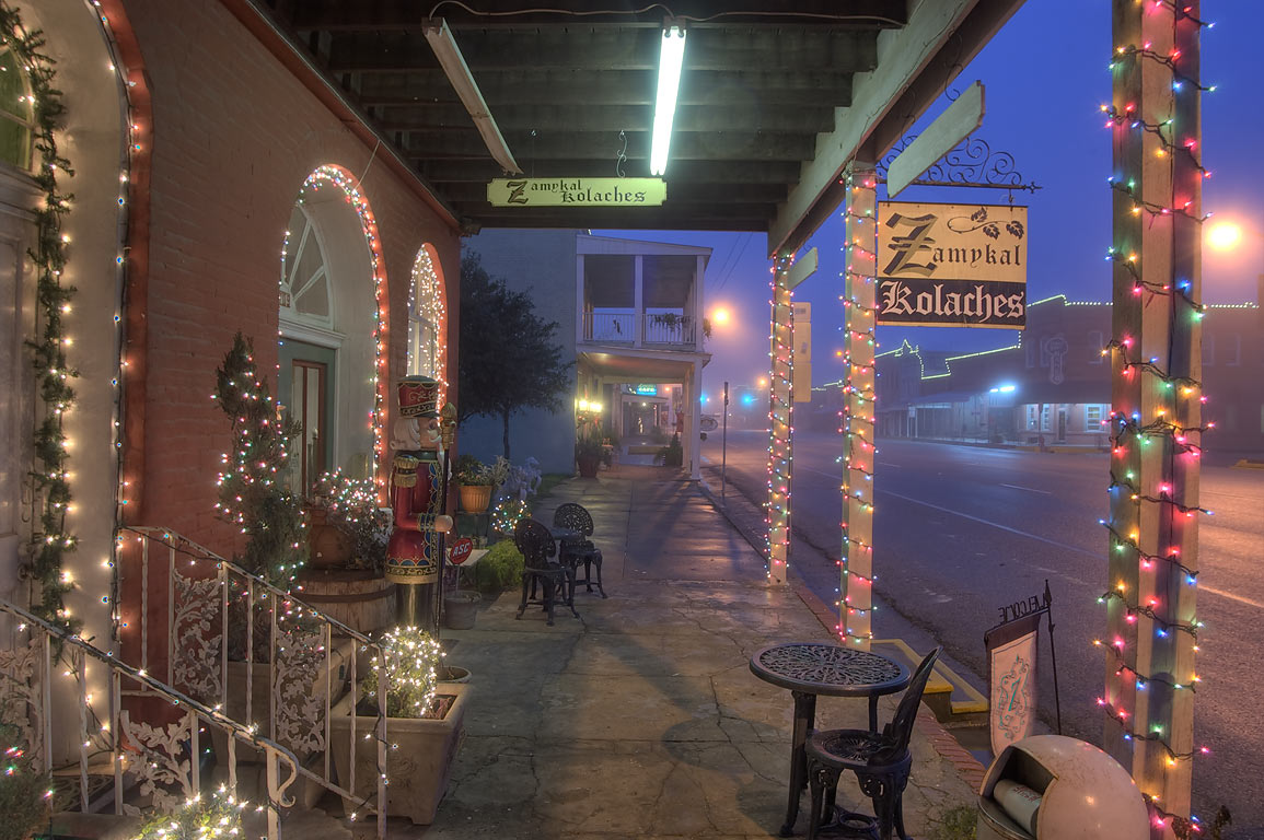Zamykal Kolaches tourist shop at 709 Main St. with Christmas lights. Calvert, Texas