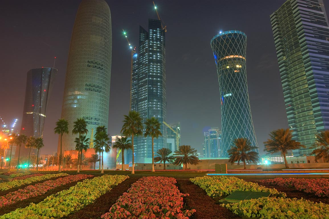 Flower beds opposite to teapot sculpture near...on Corniche in West Bay. Doha, Qatar