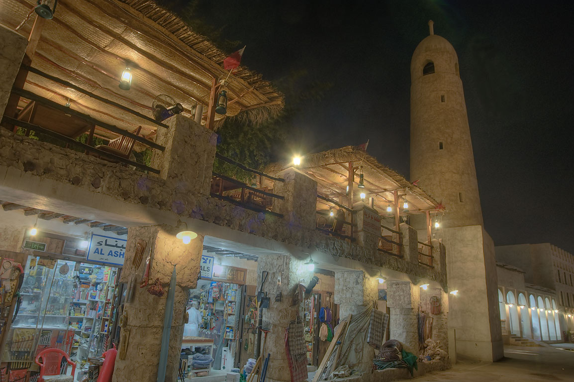 Garden shop and a mosque in Souq Waqif (market) at evening. Doha, Qatar