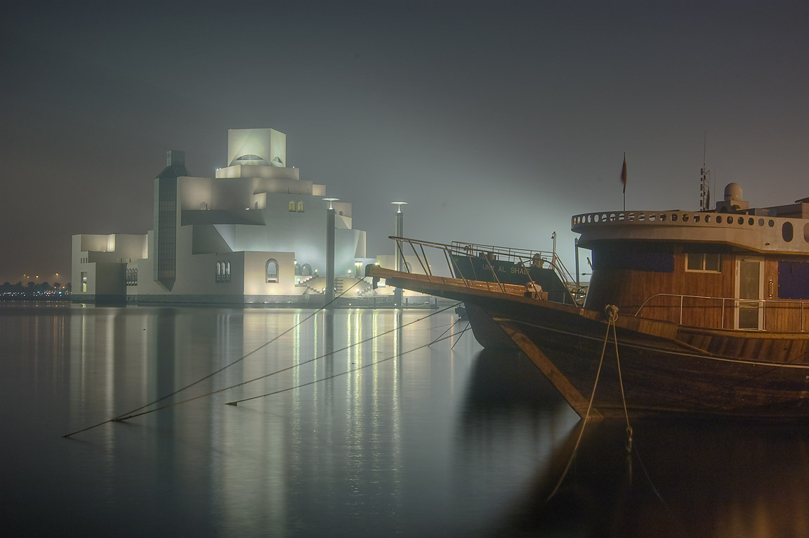 Dhow boats and Museum of Islamic Art from Corniche at morning. Doha, Qatar