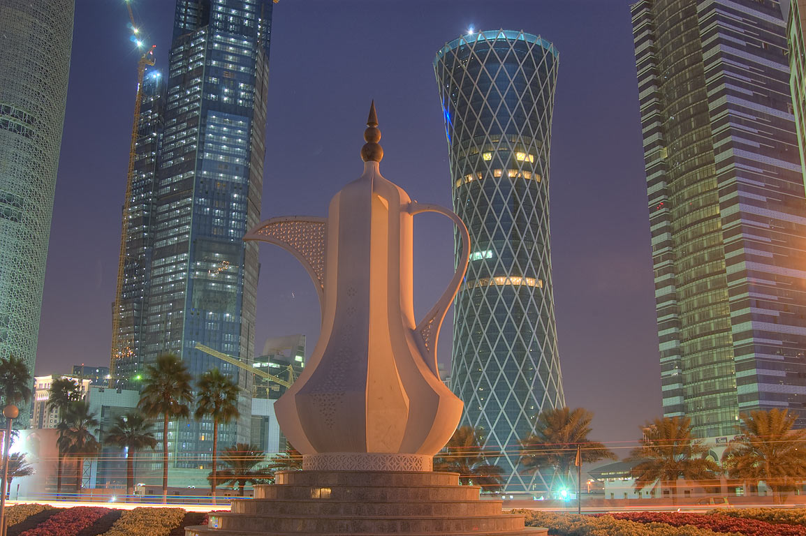 Teapot sculpture (dallah, or coffee pot monument...Bay towers from Corniche. Doha, Qatar
