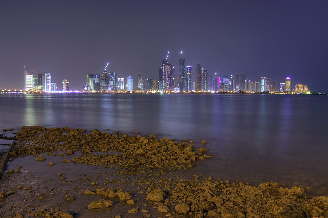 View of West Bay from Corniche (seafront promenade) across harbor at low tide. Doha, Qatar