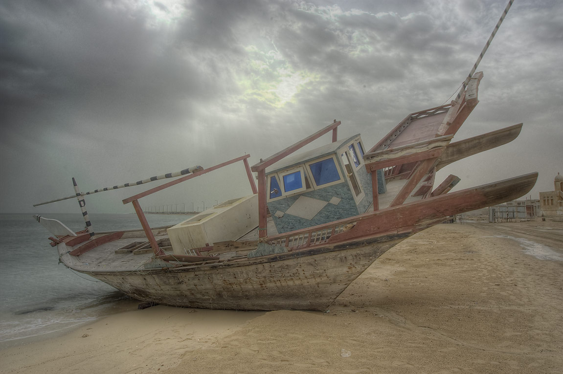 Beached dhow fishing boat in Al Wakra, south from Doha. Qatar