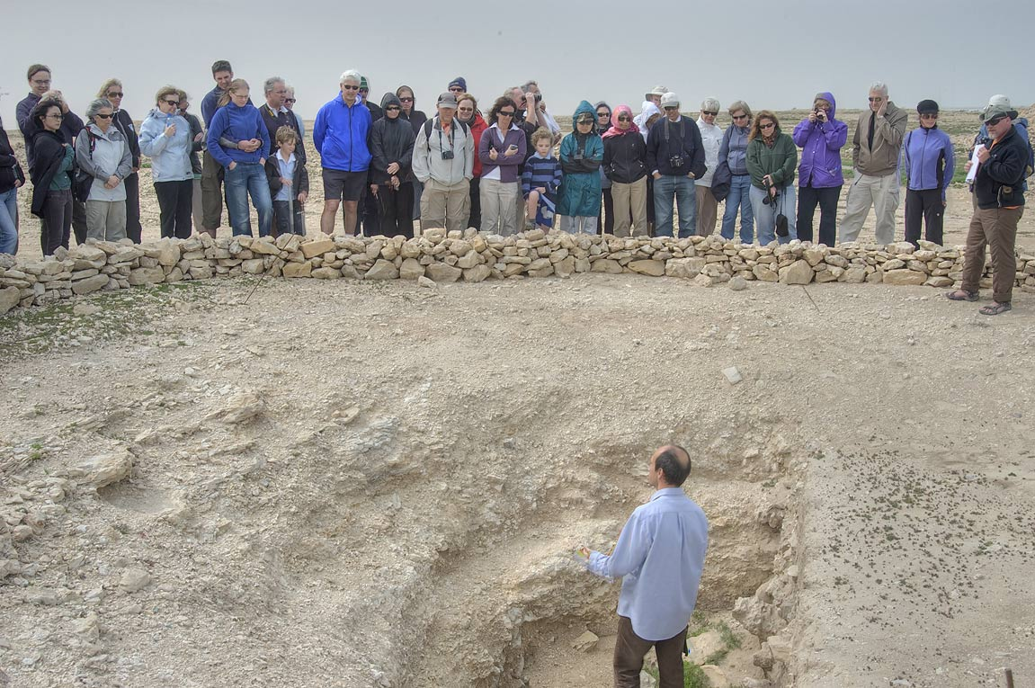 Dr. Petersen in an excavated mound guiding a tour...for Qatar Natural History Group. Qatar