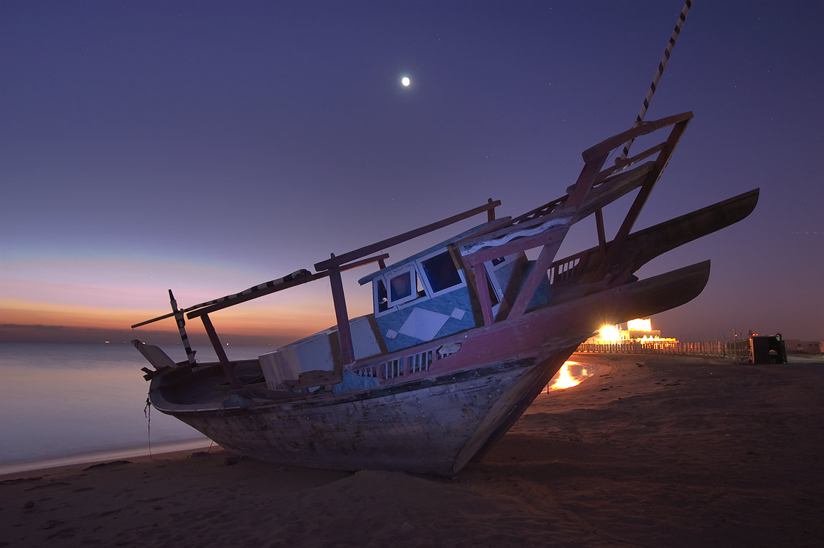 Beached dhow fishing boat at morning dusk in Al Wakra, south from Doha. Qatar