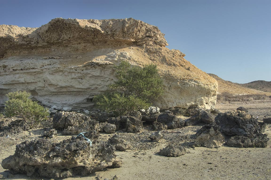 Low limestone cliffs in Purple Island (Jazirat Bin Ghanim). Al Khor, Qatar