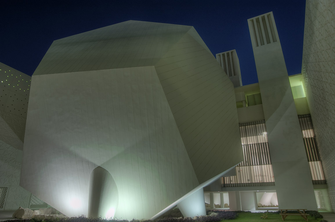 Dodecahedron lecture hall and wind towers of...City campus at evening. Doha, Qatar