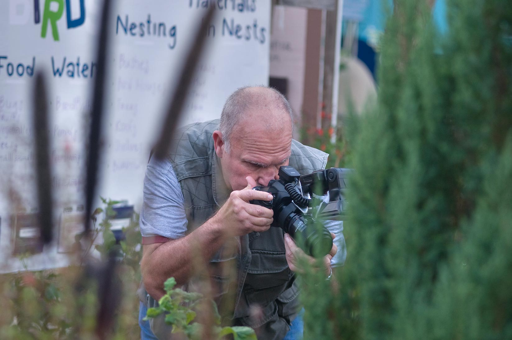 Nature photographer in TAMU Horticultural Gardens...M University. College Station, Texas