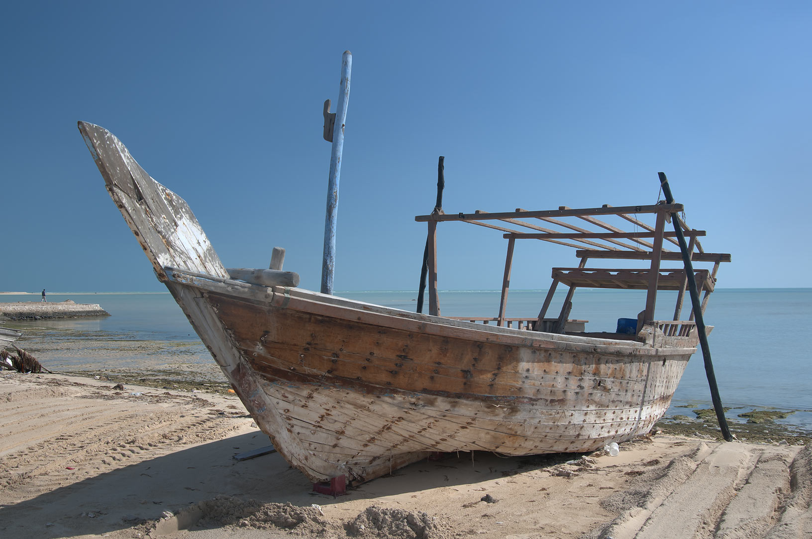 Beached traditional dhow boat in Al Wakra, Qatar
