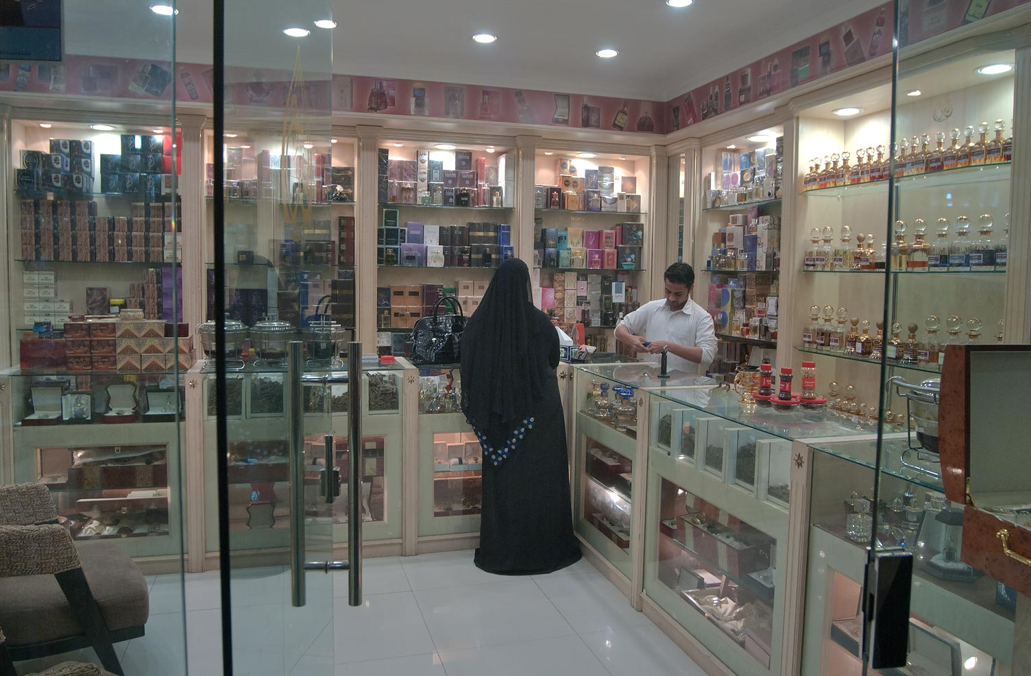 A woman shopping for perfumes in Souq Waqif (Old Market). Doha, Qatar