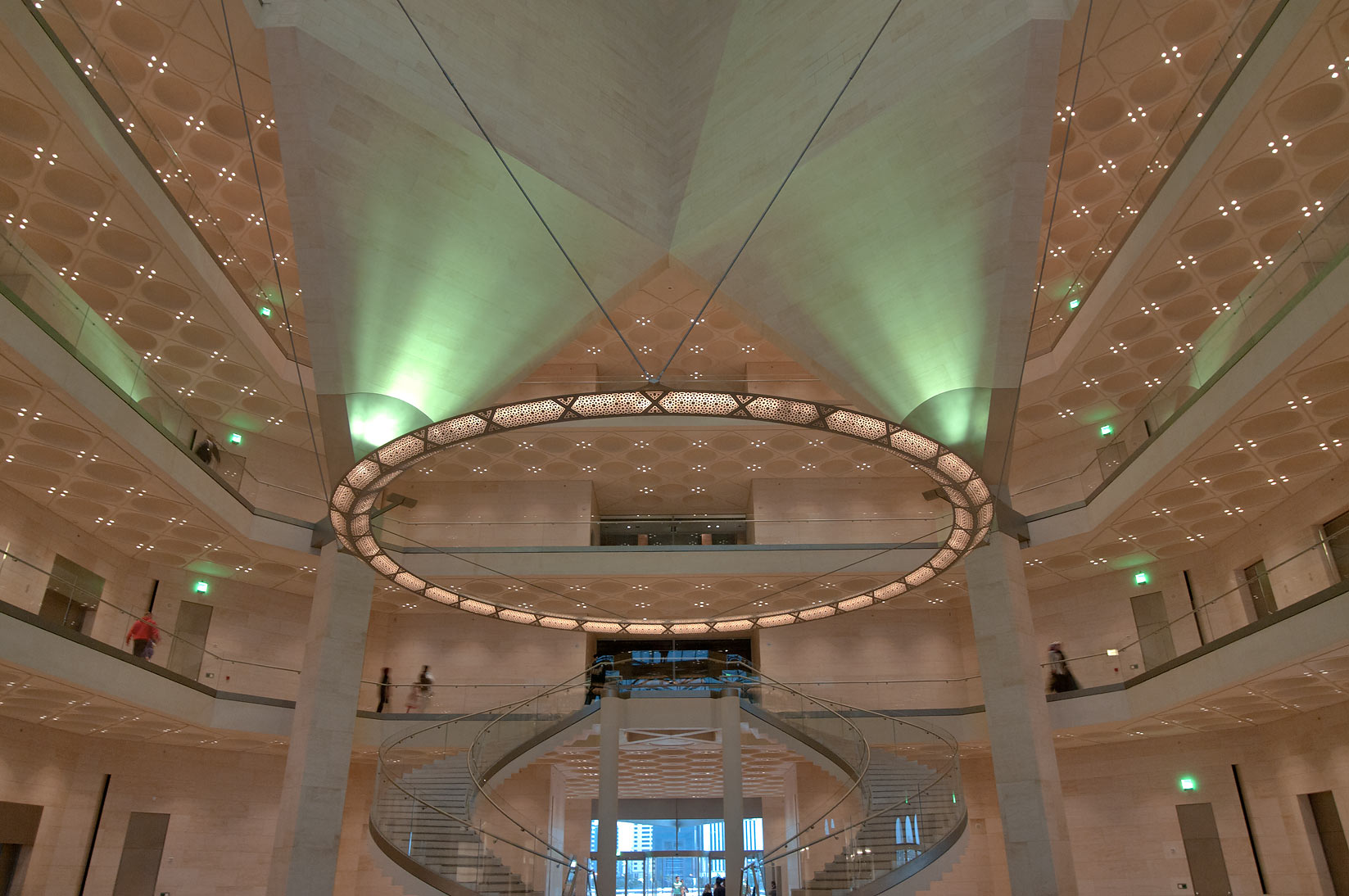 Stairs and perforated metal chandelier of Museum of Islamic Art. Doha, Qatar