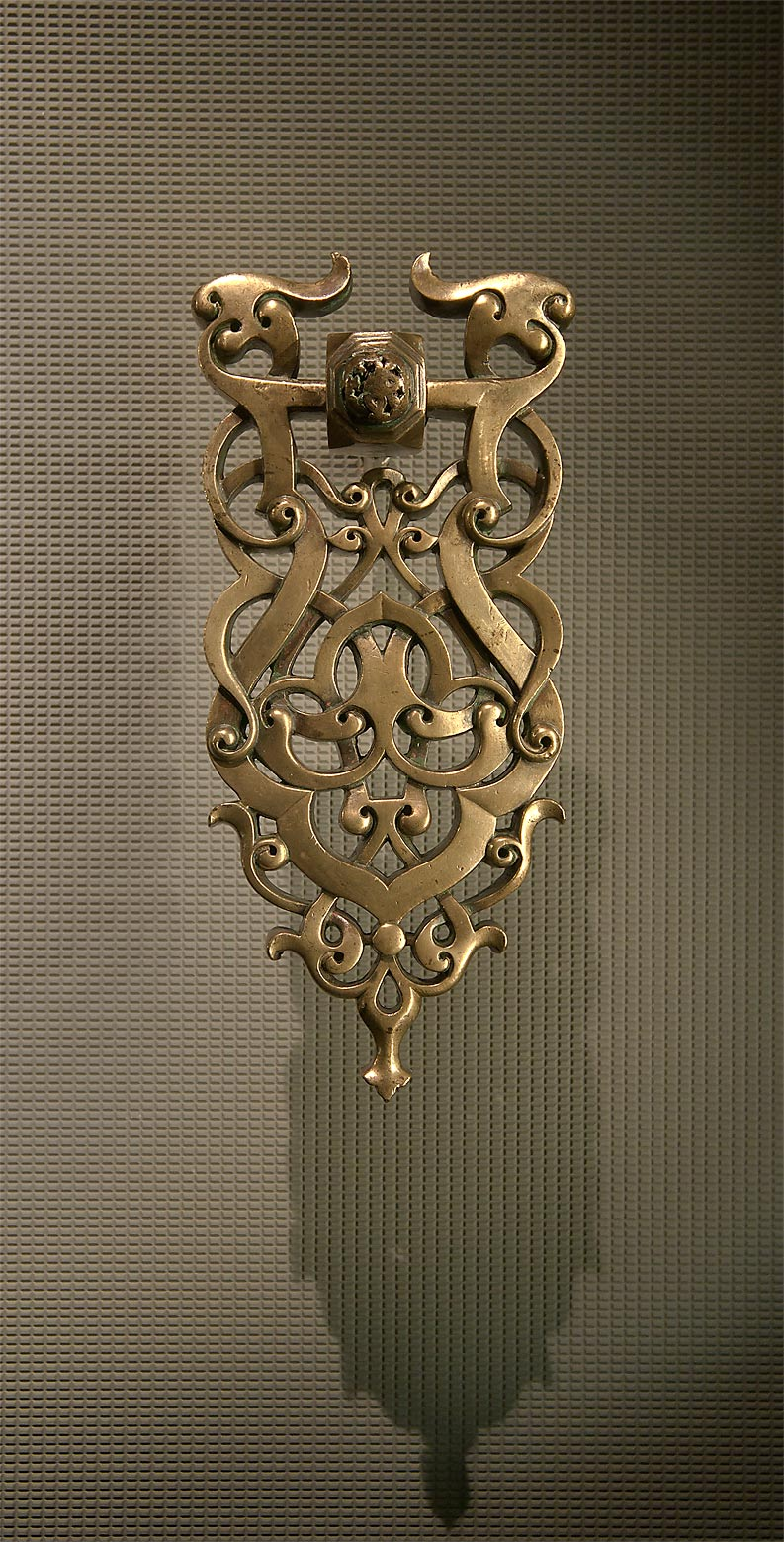Door knocker (13th century, brass) on display in Museum of Islamic Art. Doha, Qatar