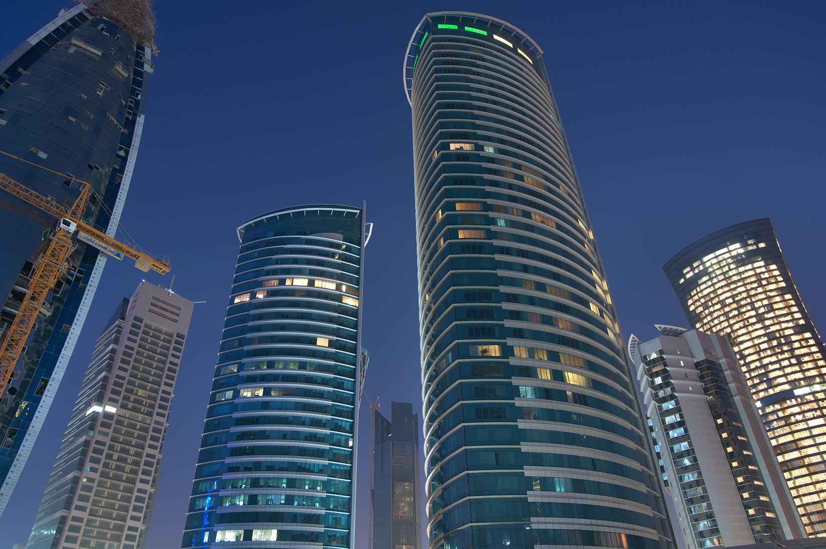 Office towers in West Bay at morning, view from a...of City Center Mall. Doha, Qatar