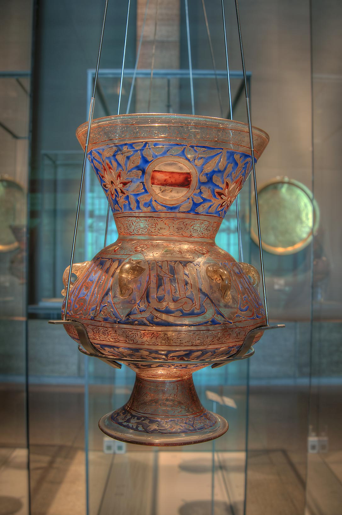 Mosque lamp with vitreous enamel on display in Museum of Islamic Art. Doha, Qatar