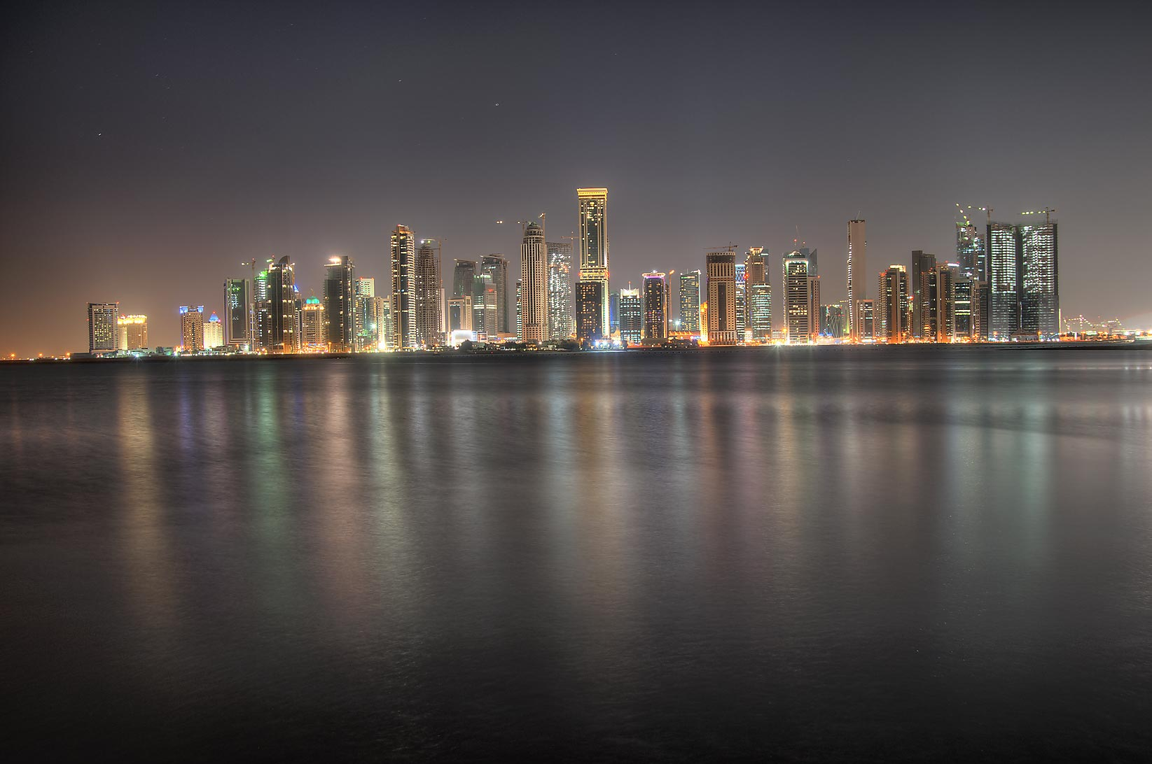 West Bay lights from a beach south of InterContinental Hotel. Doha, Qatar