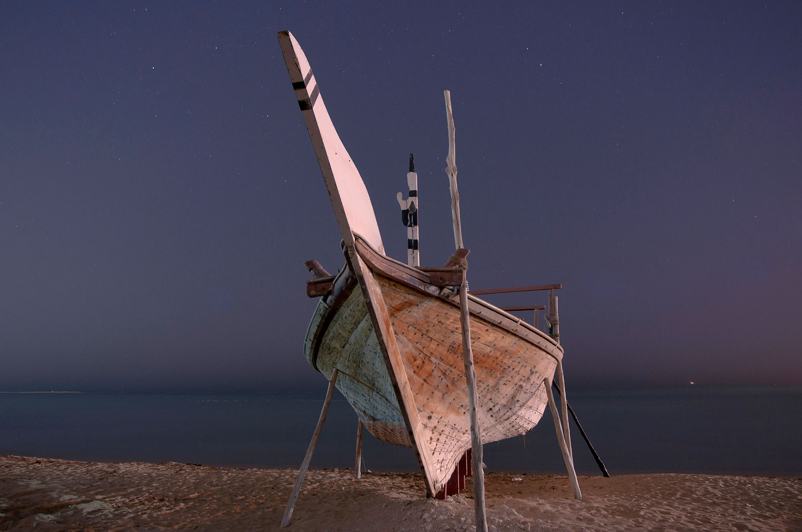 Beached fishing boat in heritage village. Al Wakrah, Qatar