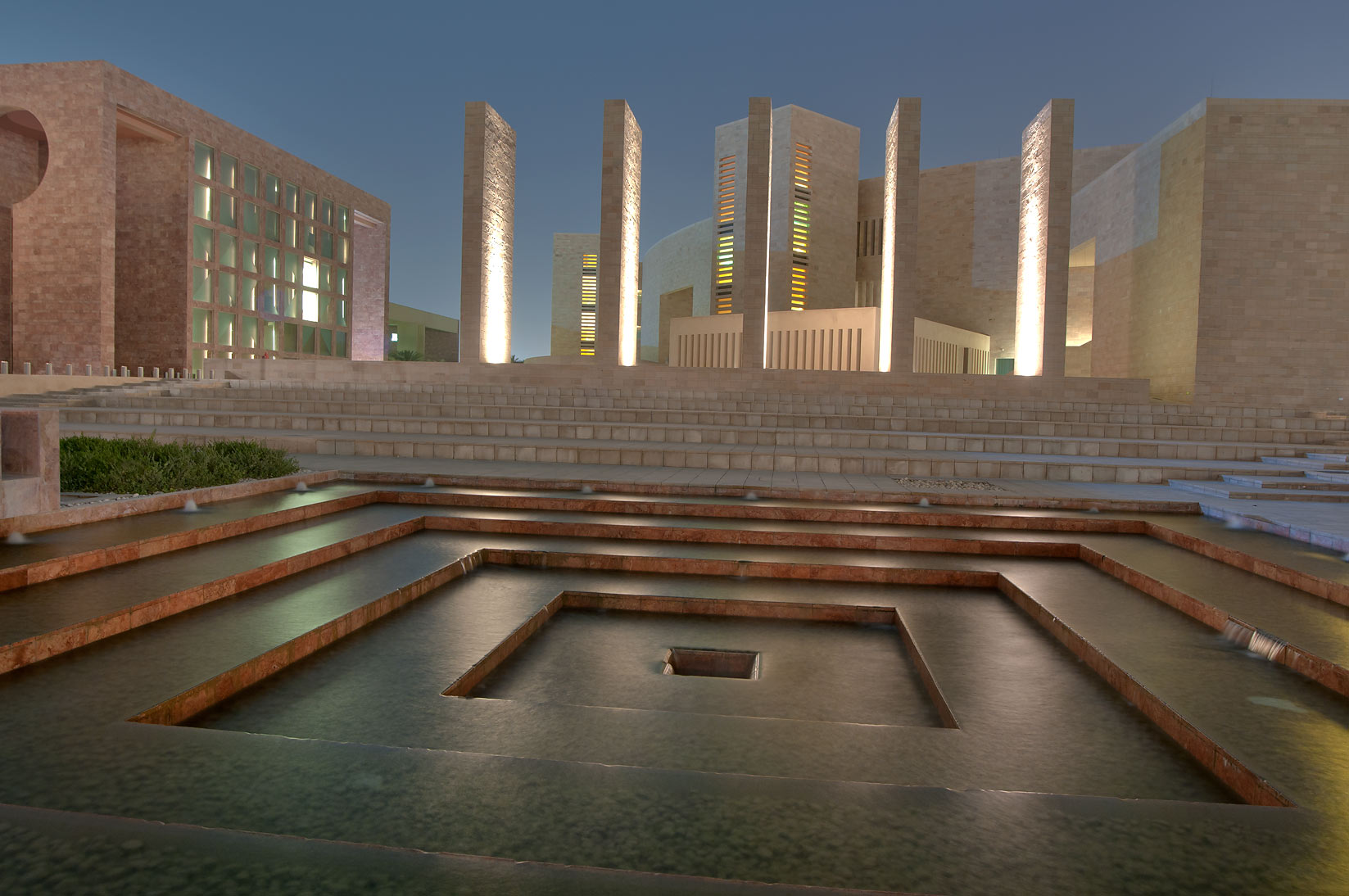 Fountain of Carnegie Mellon University in Education City campus at evening. Doha, Qatar