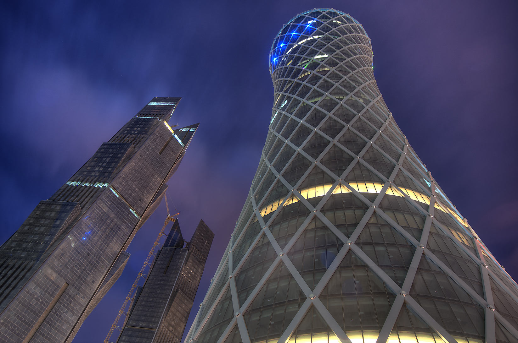 Tornado (QIPCO) and twin Palm towers in West Bay at morning. Doha, Qatar