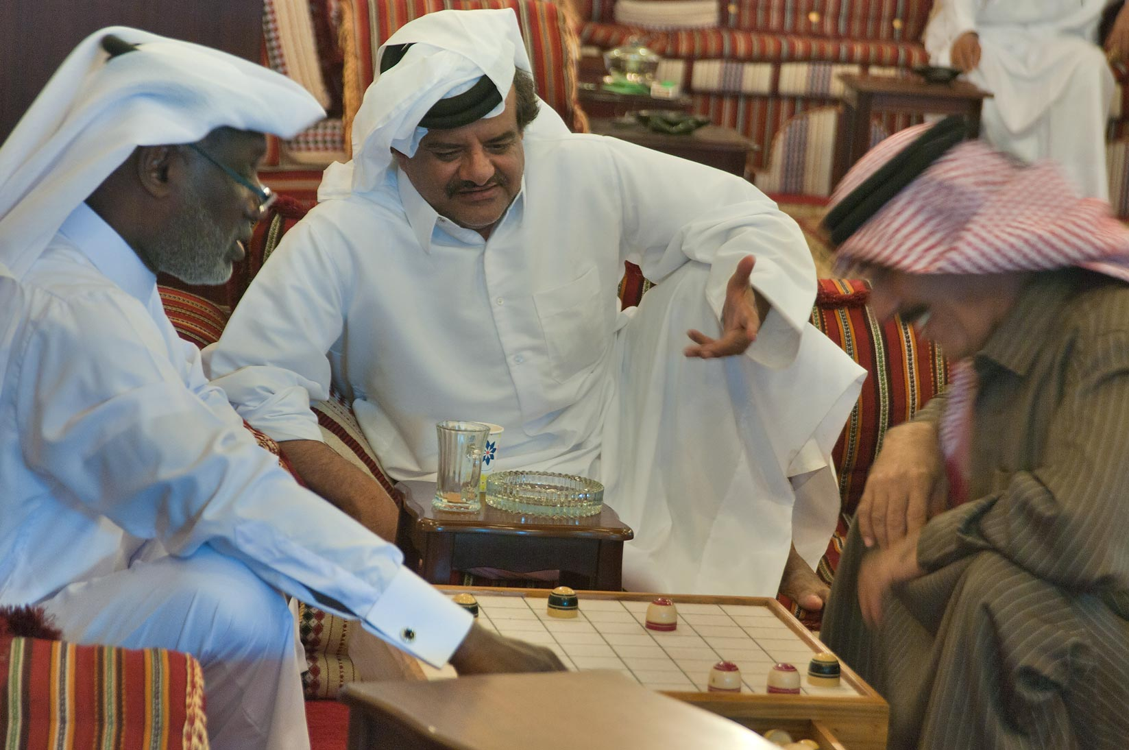 Playing a board game of Damah in Souq Waqif (Old Market). Doha, Qatar